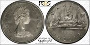 1975 $1 Voyageur Attached Jewels MS65